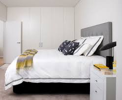 feng shui bedroom design idea that apply yin and yang element where black which represented as the yin is very harmonious with white furniture and wall apply feng shui