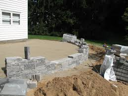 stone patio installation: paver wall design landscape designer backyard patio