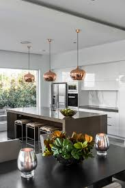 contemporary residence inspiration for a contemporary galley kitchen remodel in brisbane with flat panel cabinets white awesome vintage industrial lighting fixtures remodel