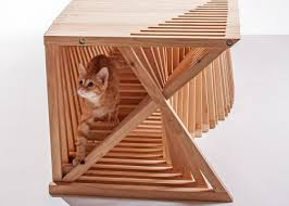 a group of architects teamed up to produce sculptural modern cat furniture for the giving shelter fundraiser which donated its proceeds to the non profit cat modern furniture