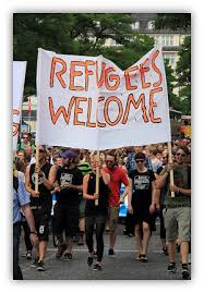 home   eng    argumentative essays  amp  controversial issues    demonstrators   in the street holding a sign that says   quot refugees welcome  quot  argumentative  amp  controversial issues